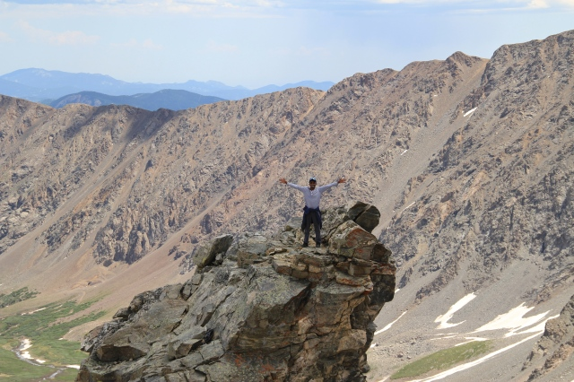 Friend standing on craggy peak on Gray's peak
